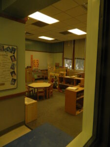 looking-into-a-toddler-classroom-from-the-observation-booth-at-the-child-development-labs